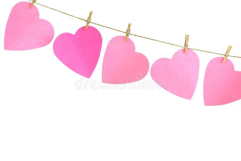 Coeurs sur une corde à linge images stock