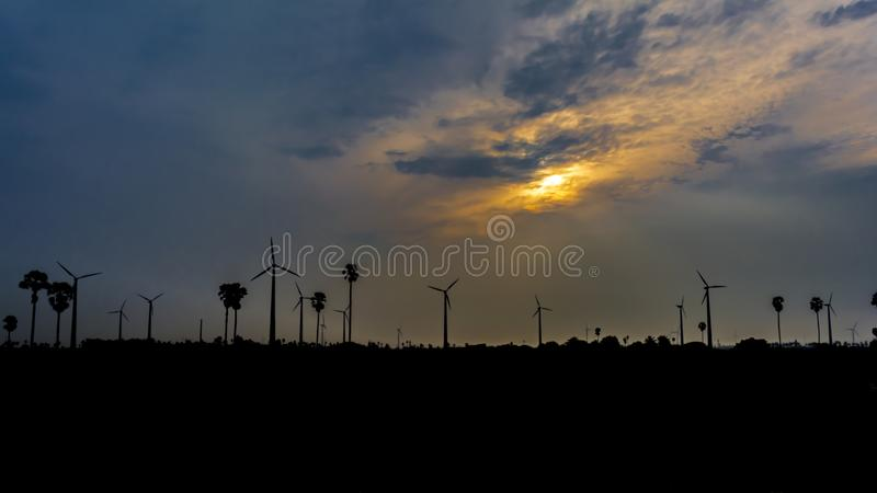Coexistence of Science and Nature. A powerful picture displaying how true development can happen in an eco-friendly way. Picture showing palm trees and dense royalty free stock photos
