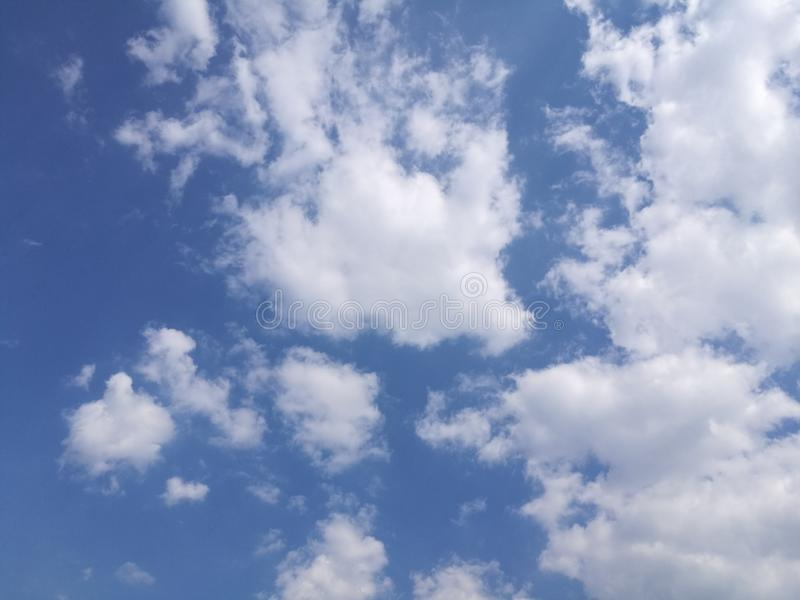 Amazing clouds in the sky on a nice and warm day. Cof amazing clouds nice warm sky day royalty free stock photo