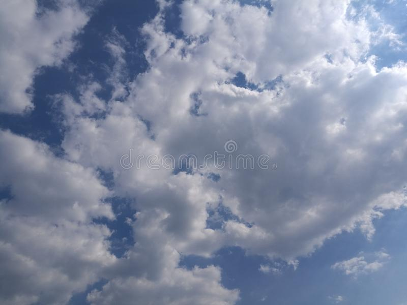 Amazing clouds in the sky on a nice and warm day. Cof amazing clouds sky nice warm day stock photo