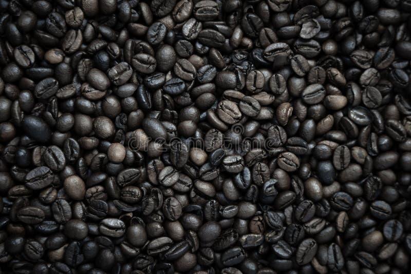 Coffe bönatextur med brunt och svart arkivbilder