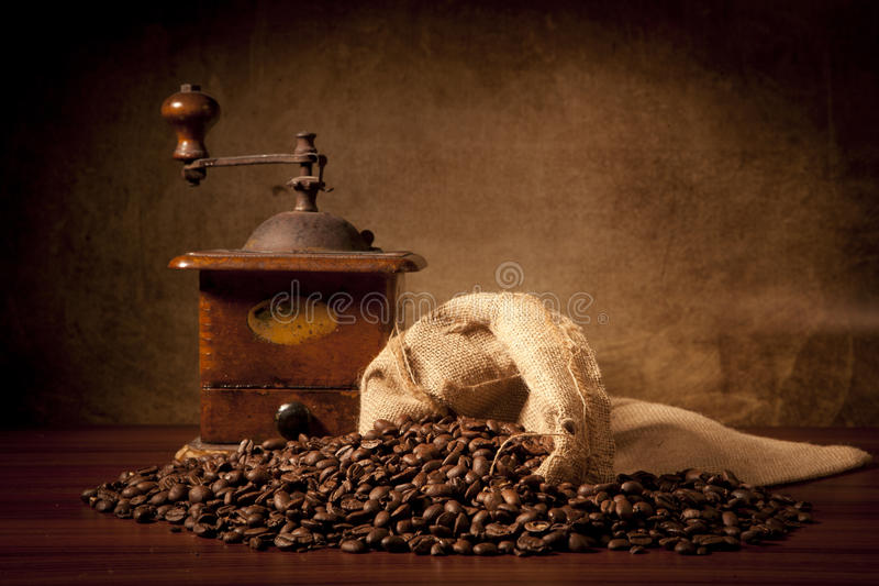Coffe beans with juta bag and grinder royalty free stock photo
