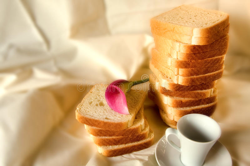 Coffe bread and flower. In a white background royalty free stock photo