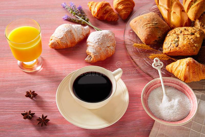 Coffe breakfast with orange juice croissant bread. And yogurt royalty free stock photo