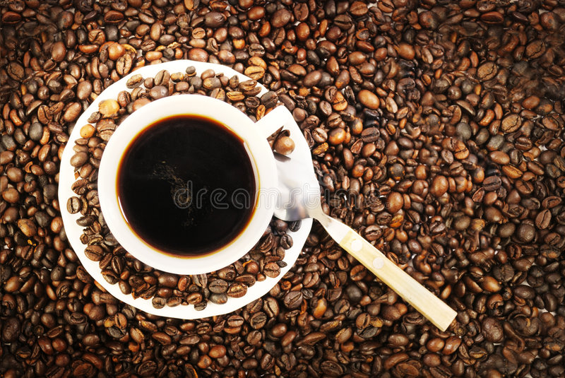 Coffe Cup. Cup of coffee with coffee grain royalty free stock images