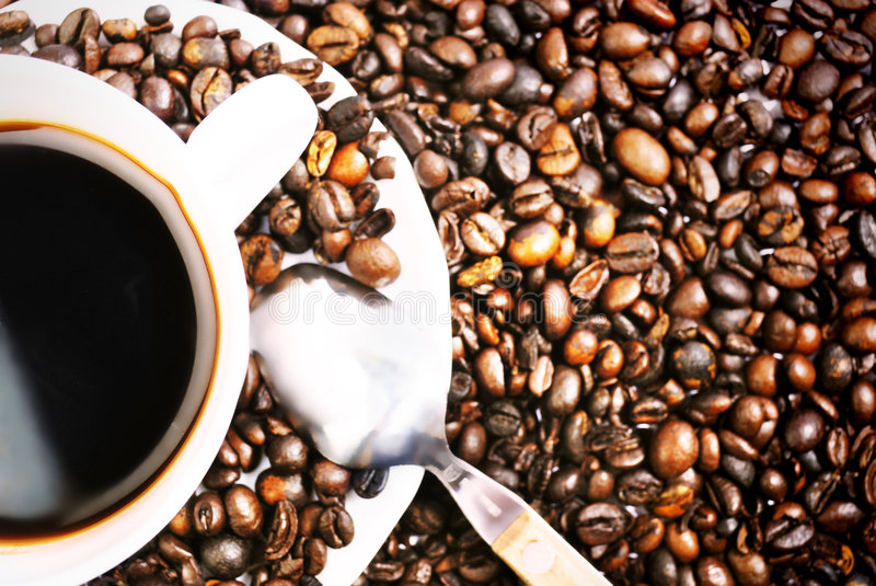 Coffe Cup. Cup of coffee with coffee grain stock images