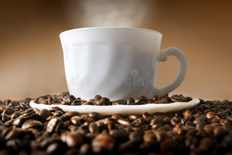 Coffe Cup. Cup of coffee with coffee grain royalty free stock image