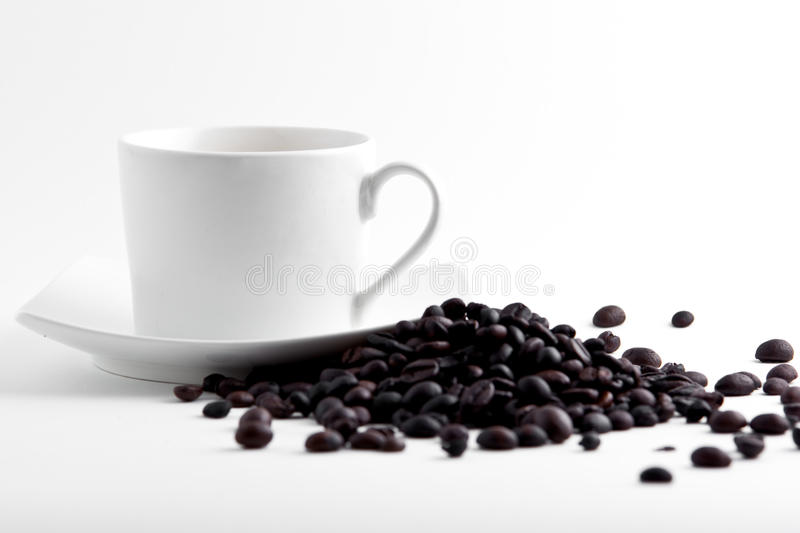 Coffe cup and beans stock image