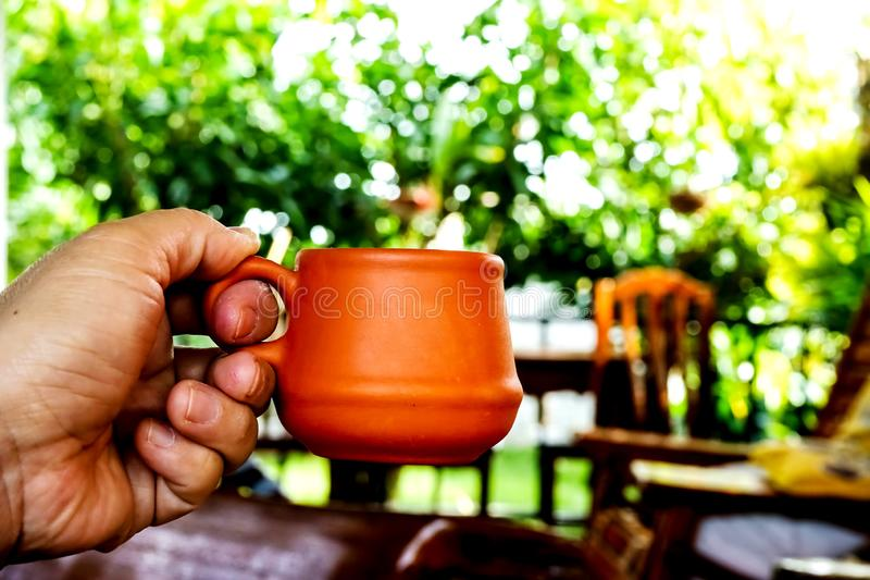 Coffe  cup. Hand holding a cup of coffee ,boken is background stock images