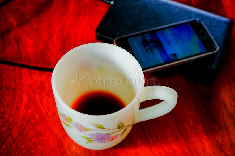 Coffe  cup and smart phone royalty free stock images