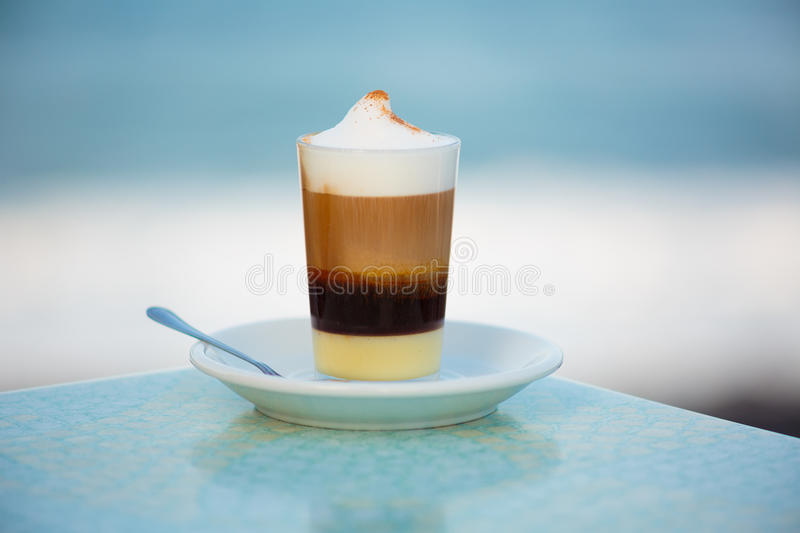 Coffe. A cup of white coffe royalty free stock photo