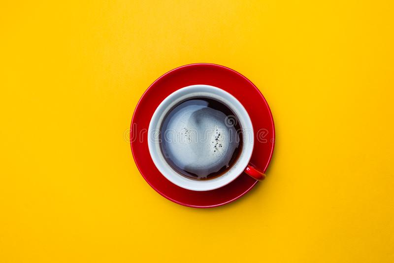 Coffe cup on yellow royalty free stock photography