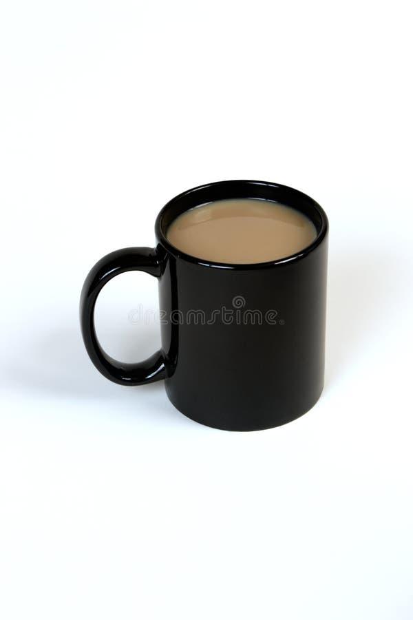 Coffe in een zwarte mok royalty-vrije stock afbeeldingen