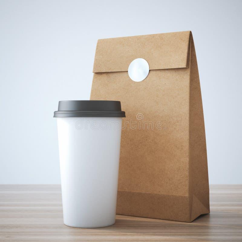 Coffe filiżanka i papierowa torba zdjęcia royalty free
