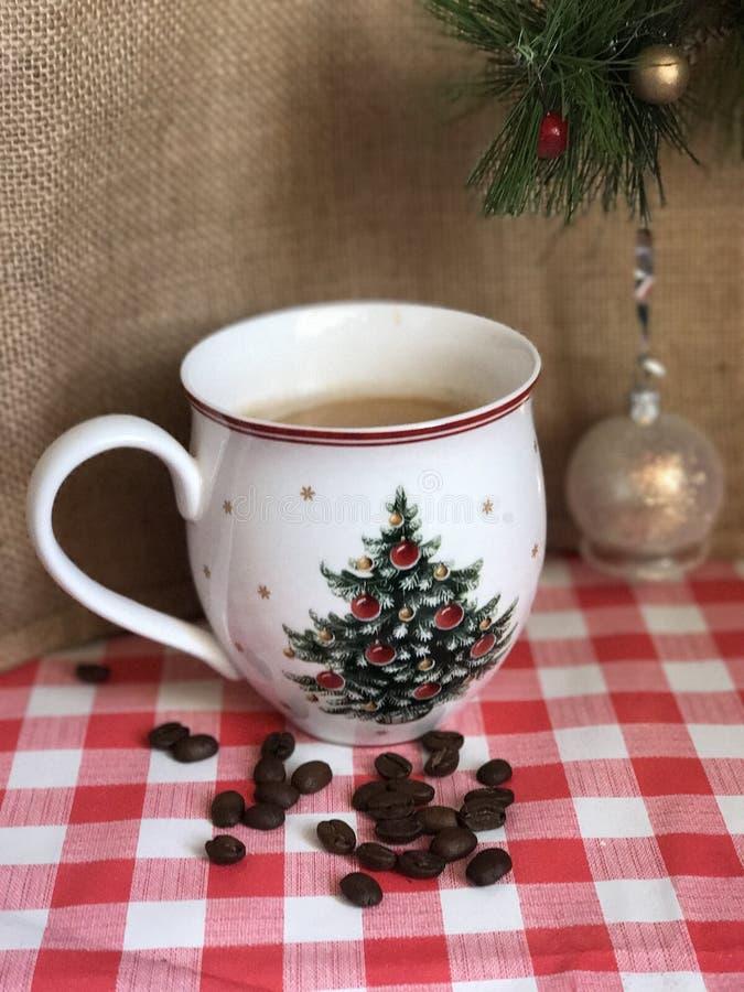 Coffe mug Christmas. Americano coffee in white cup with Christmas decor stock photo