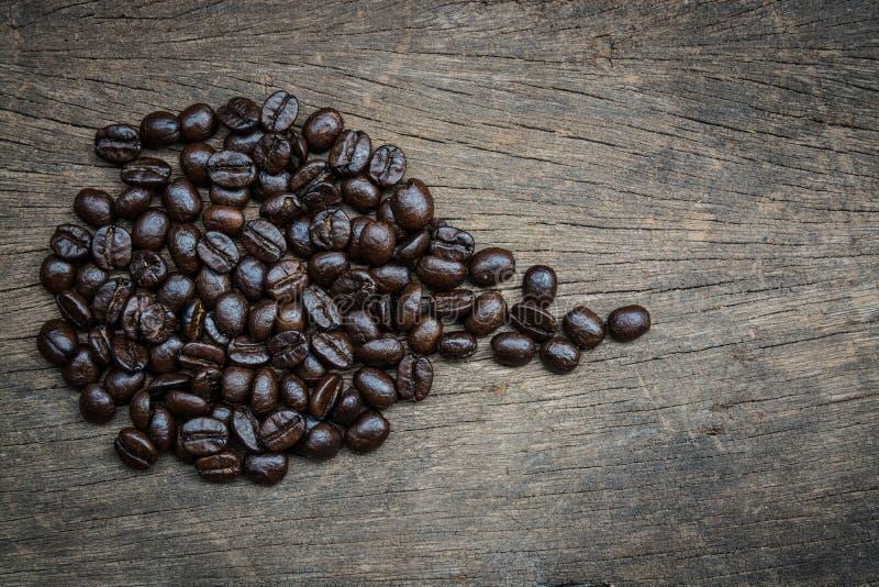 Coffe und hölzerner Hintergrund lizenzfreies stockfoto