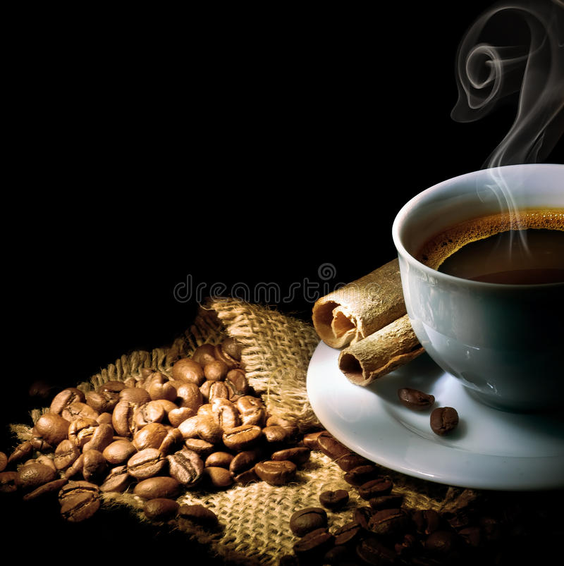 Coffee. Beautiful Cup of Coffee isolated on Black.With copy space royalty free stock photos