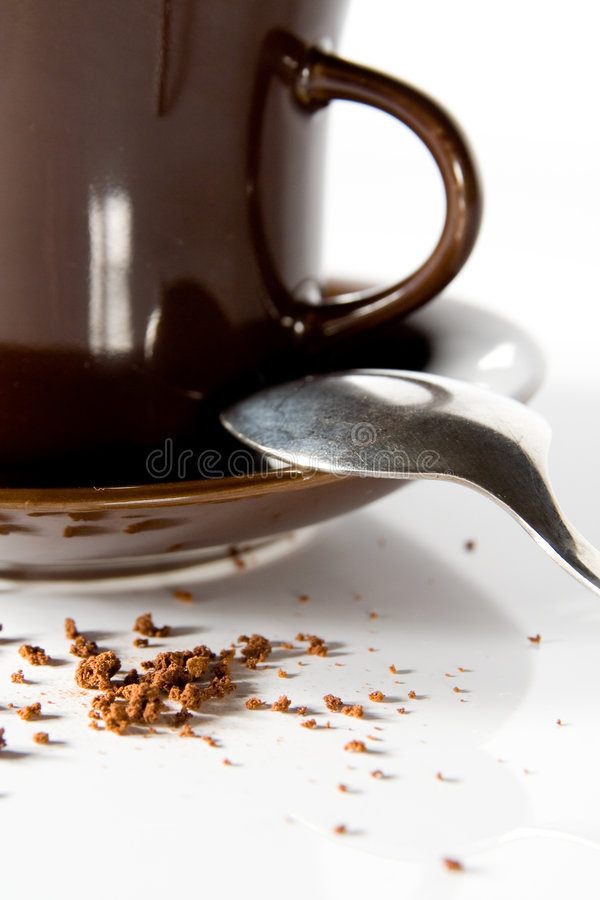 Coffee. Detail on cup, saucer and stray coffee royalty free stock photo
