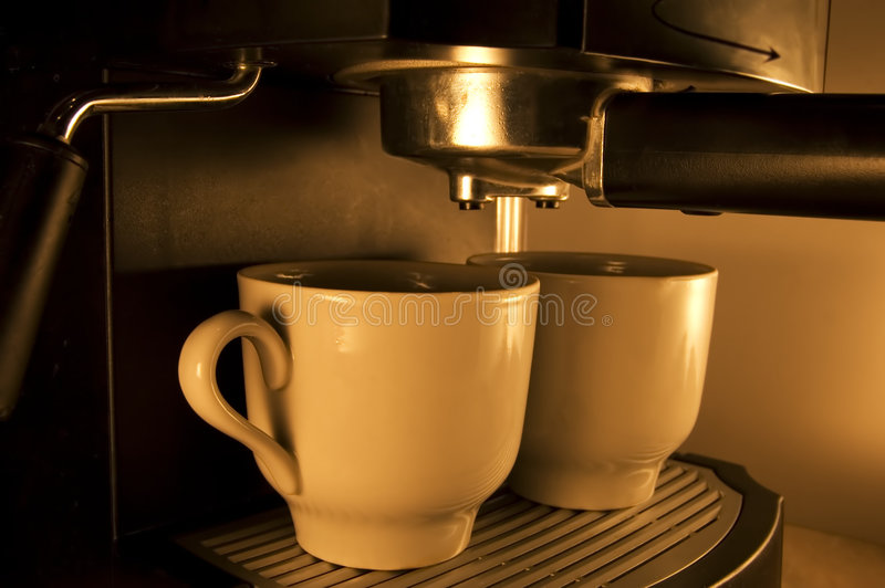 Coffee. The machine for preparation of coffee with two cups royalty free stock photos