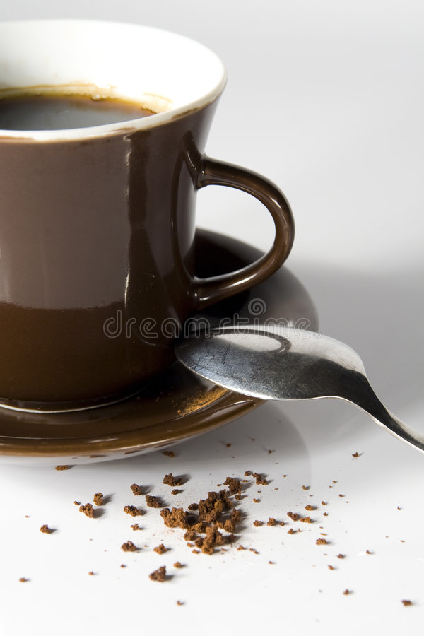 Coffee. Detail on cup, saucer and stray coffee royalty free stock images