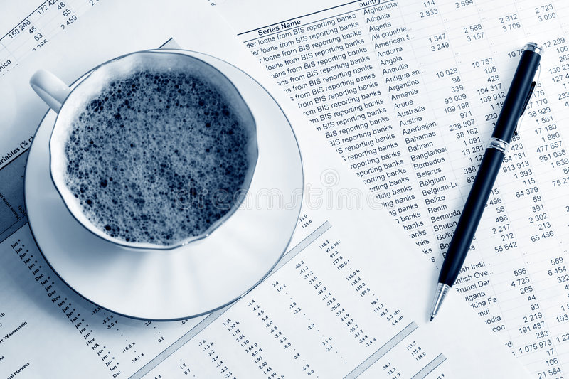 Coffee and accounting. Cup of coffee and financial accounting royalty free stock image