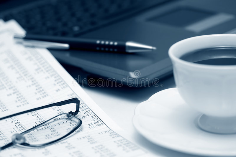 Coffee and accounting. Cup of coffee and financial analysis royalty free stock photography
