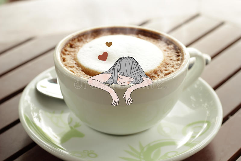Coffee addict in a coffee cup. royalty free stock photography
