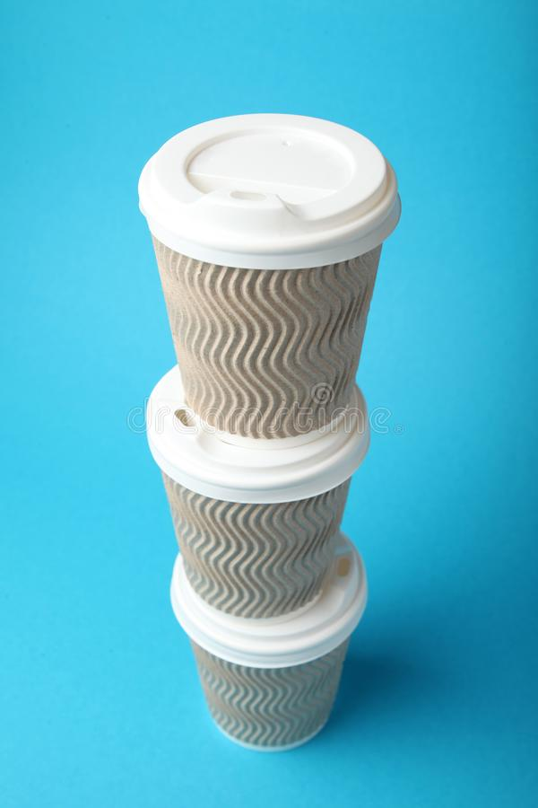 Coffee addiction, take away paper cups stock images