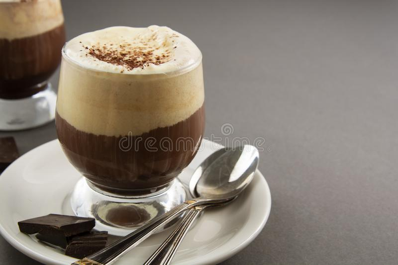 Coffee affogato with vanilla ice cream and espresso. Glass with coffee drink and icecream. Copy space stock image