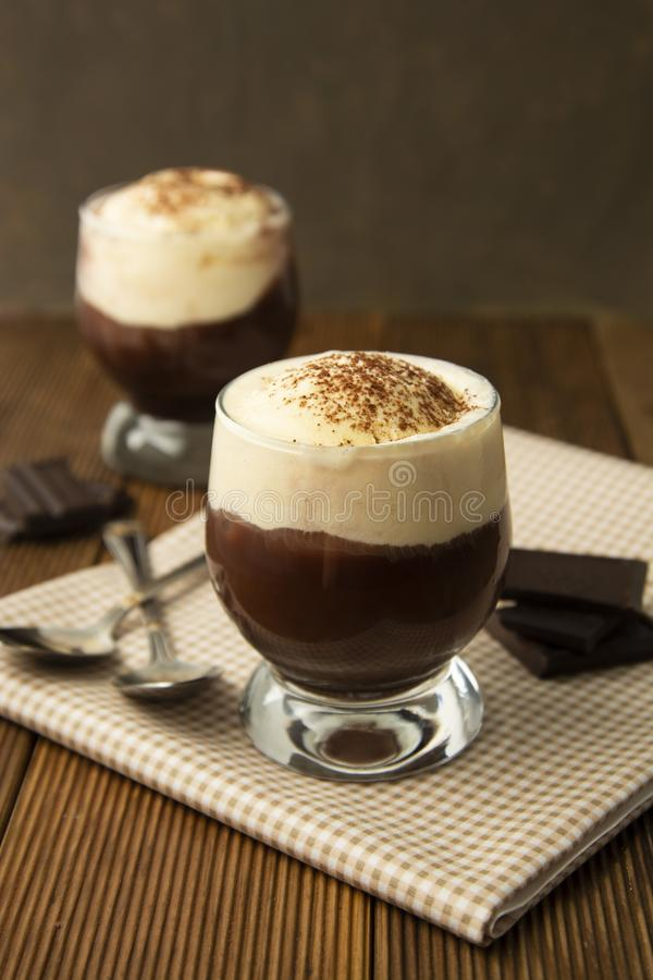 Coffee affogato with vanilla ice cream and espresso. Glass with coffee drink and icecream royalty free stock photography