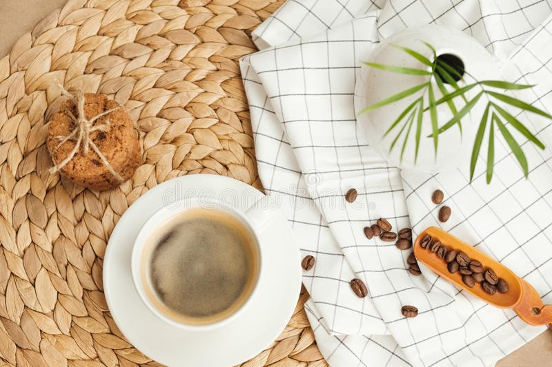 Coffee with American cookies tied with twine. coffee beans are scattered nearby royalty free stock photo