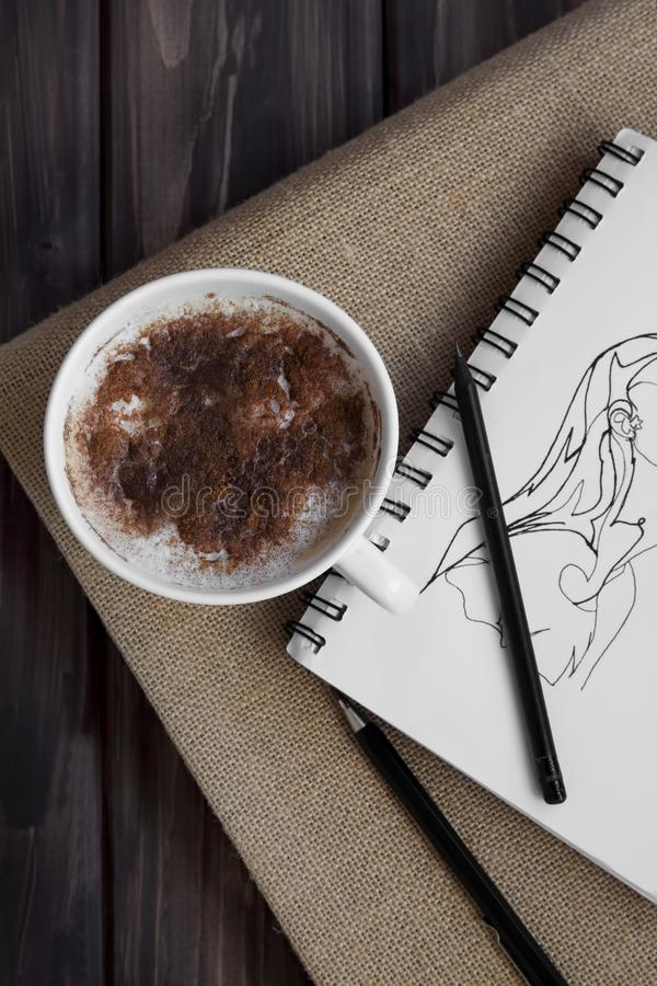 Cinnamon coffee and artsy drawing stock photo