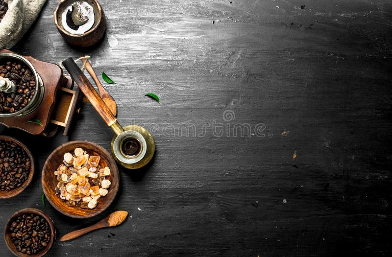 Coffee background. Fresh coffee with sugar crystals and coffee beans. stock photos