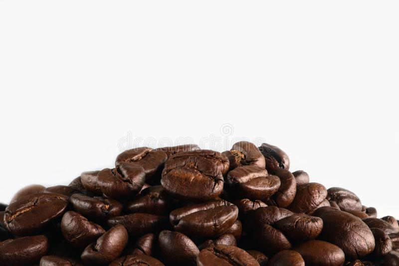 Coffee background of roasted coffee beans isolated on white background royalty free stock image