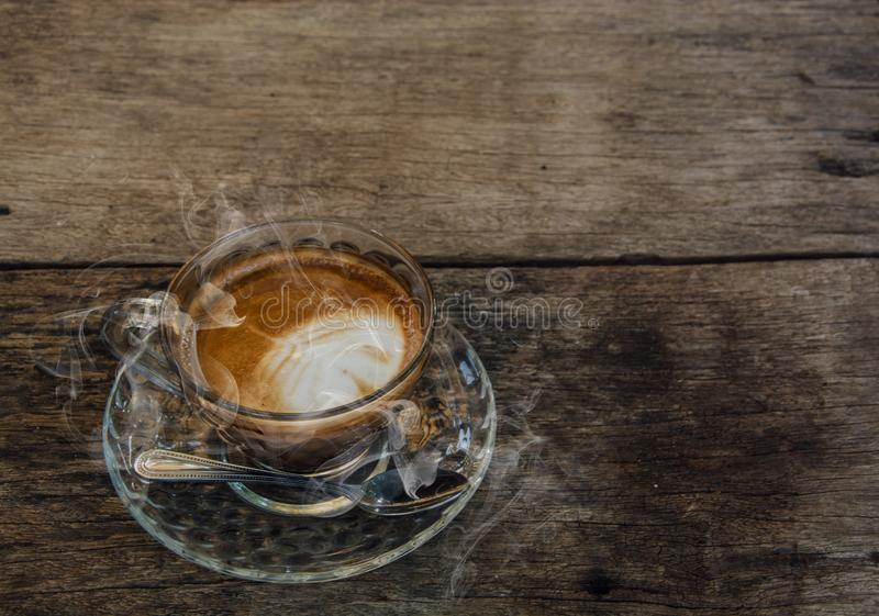 Coffee background, top view with copy space. background, cup of coffee and a smoke good morning, Hot coffee and spoon, Selective f. Ocus royalty free stock photos