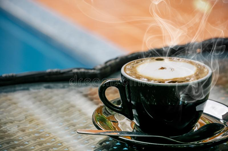 Coffee background, top view with copy space. background, cup of coffee and a smoke good morning, Hot coffee and spoon, Selective f. Ocus royalty free stock photo