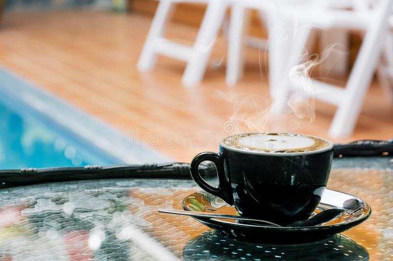 Coffee background, top view with copy space. background, cup of coffee and a smoke good morning, Hot coffee and spoon, Selective f. Ocus stock photography