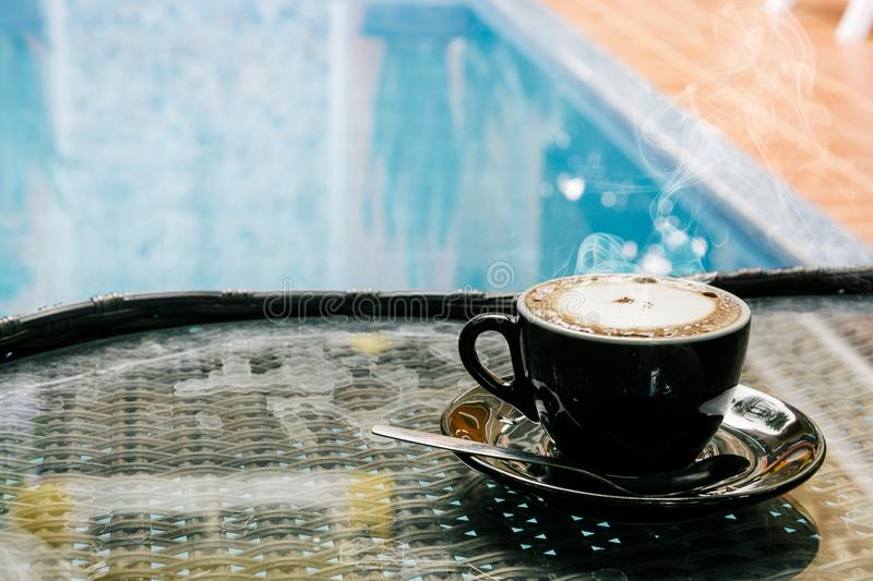 Coffee background, top view with copy space. background, cup of coffee and a smoke good morning, Hot coffee and spoon, Selective f. Ocus stock image