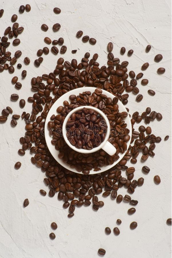 Coffee background, top view with copy space. White cup of coffee, ground coffee, coffee beans on white background stock image