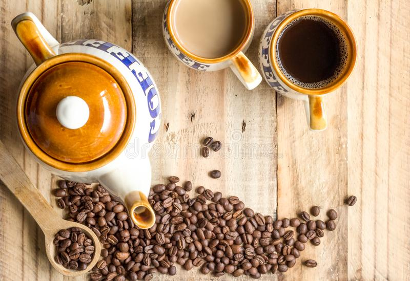 Coffee background with vintage coffee pot, mugs and coffee beans stock images