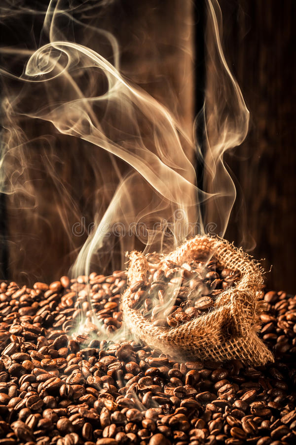 Coffee bag full of fragrance seeds royalty free stock photography