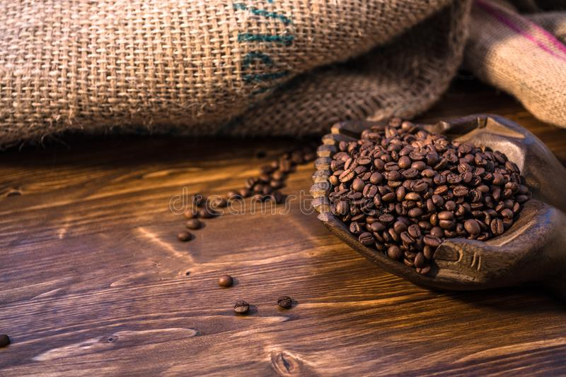 Coffee bag and heart from coffee beans on table royalty free stock images