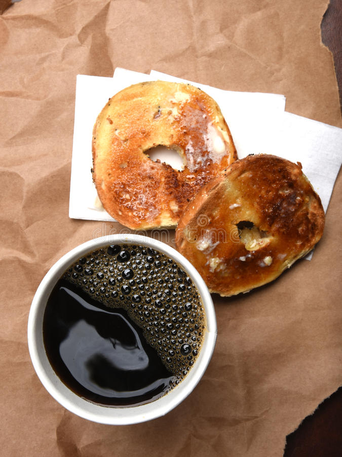 Coffee and a bagel stock photography