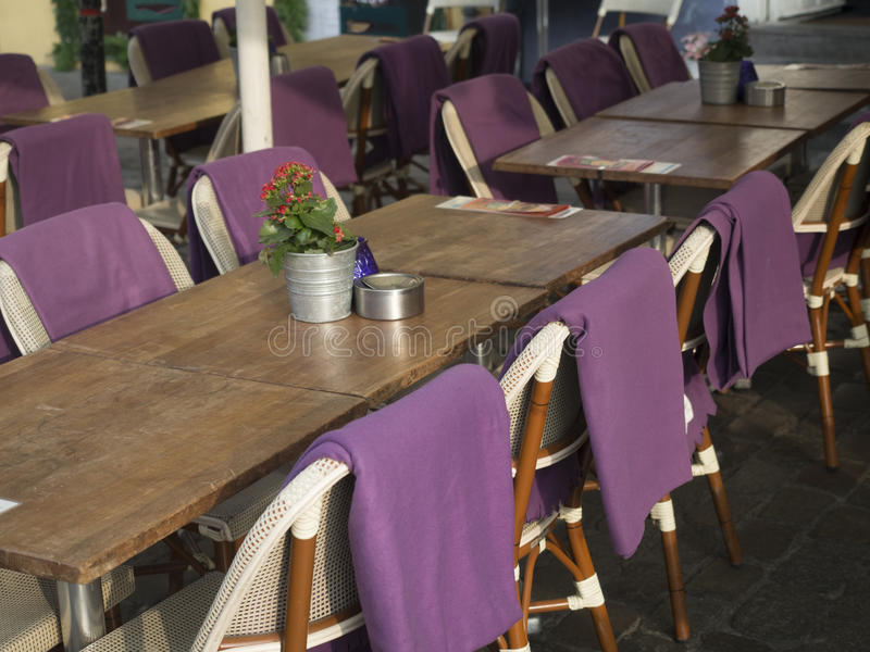 Coffee bar chairs with violet clothing royalty free stock images