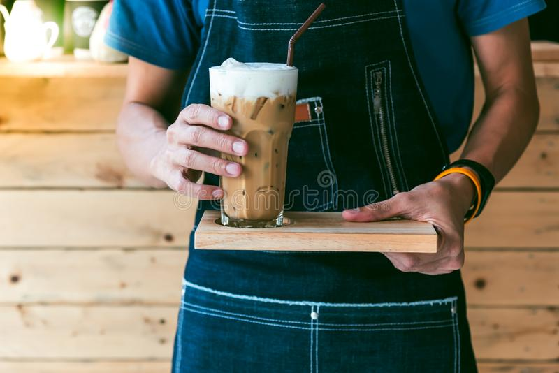 Coffee barista make cool coffee, serve customers royalty free stock photo
