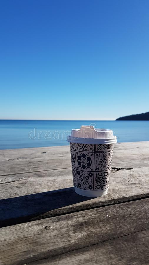 Coffee at beach royalty free stock photography