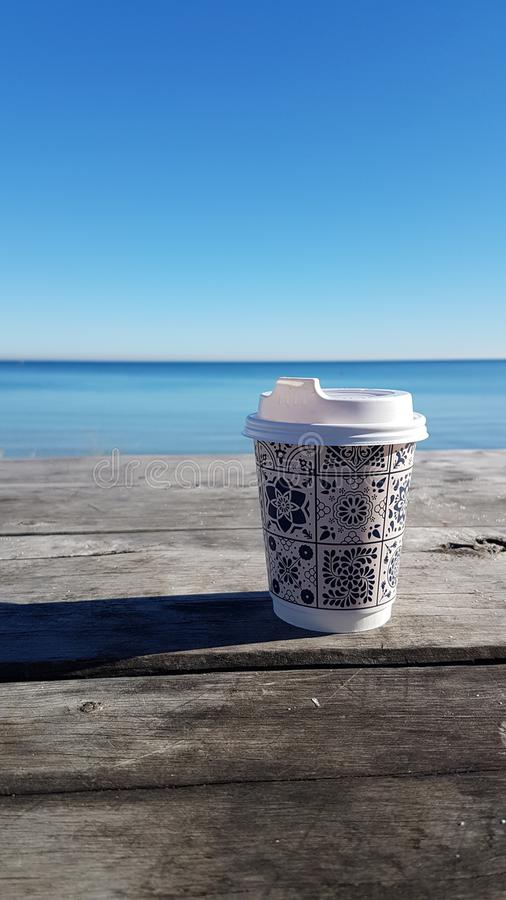 Coffee at beach stock image