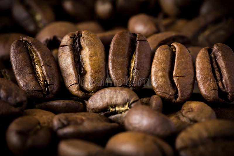 Coffee bean extremely close. Very nice background coffee on old wooden table stock image