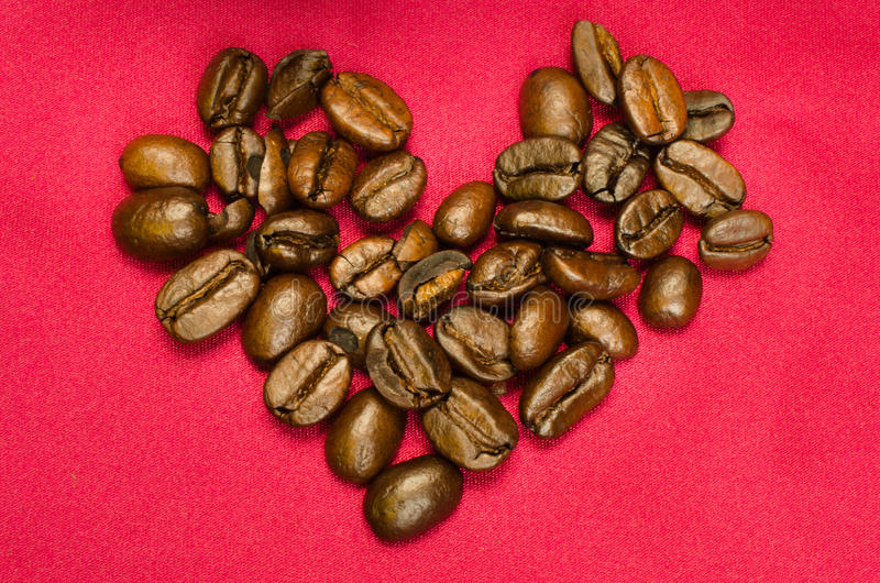 Coffee Bean Heart. A close-up shot of a heart made of coffee beans stock photos