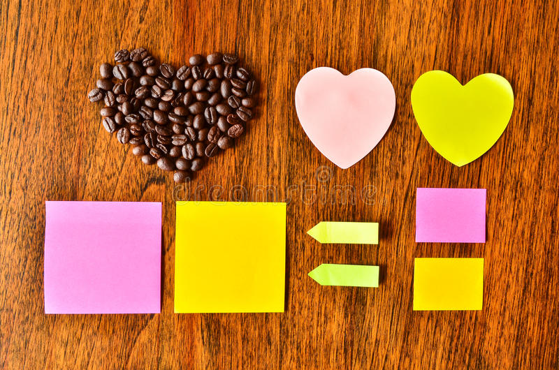 Coffee bean with heart shape and colorful stick note royalty free stock photo